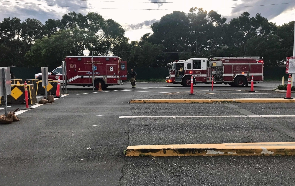 Emergency response vehicles wait outside the Nimitz Gate entrance to the Pearl Harbor Naval Shipyard to assist with a fatal shooting incident, in Honolulu, Hawaii, on Wednesday. — AFP