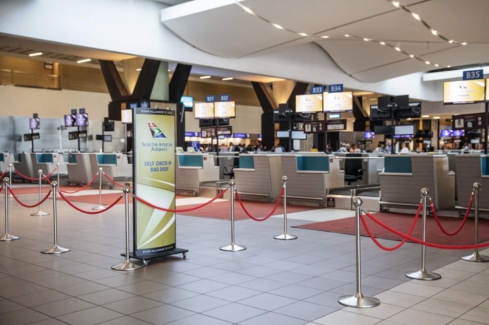 Empty SAA (South African Airways) check-in counters are seen at the O.R. Tambo International Airport in Johannesburg, South Africa, in this November 15, 2019 file photo. — AFP