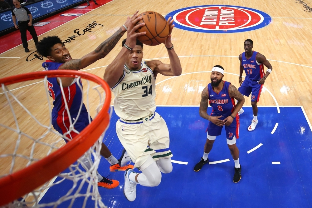 Giannis Antetokounmpo No. 34 of the Milwaukee Bucks drives to the basket past Langston Galloway No. 9 of the Detroit Pistons during the second half at Little Caesars Arena on Wednesday in Detroit, Michigan. Milwaukee won the game 127-103. — AFP
