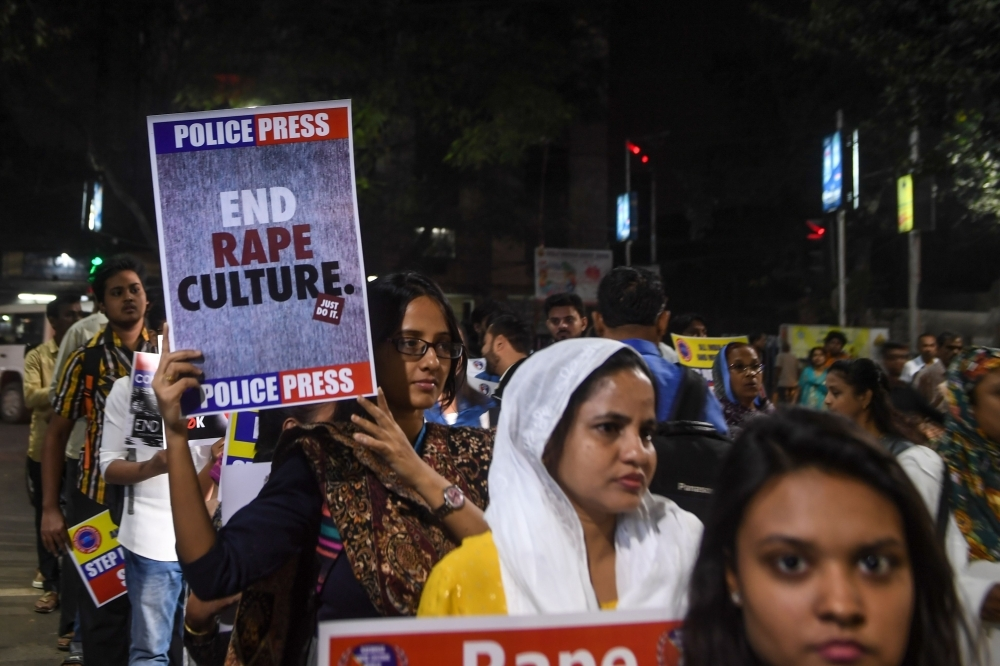 A demonstrator holds a placard to protest against sexual assaults on women, following the alleged gang rape and murder of a 27-year-old veterinarian in Hyderabad and other recent sexual assaults, during a march in Kolkata on Wednesday. — AFP