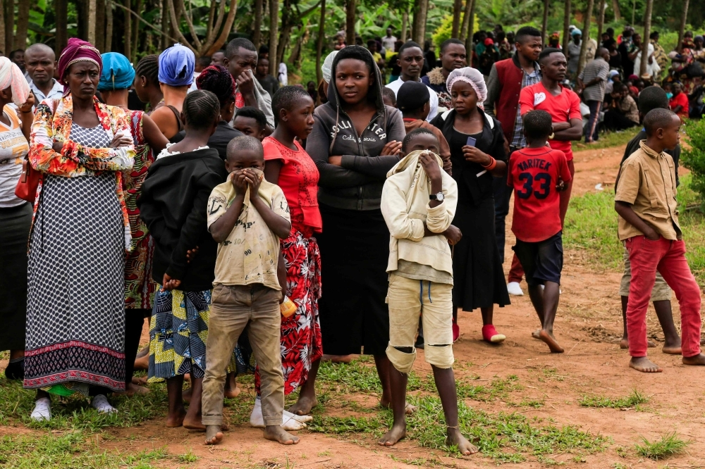 People gather in Oicha, D.R. Congo, as 27 victims of the latest massacre in the country's volatile east get buried in this Nov. 29, 2019 file photo. — AFP