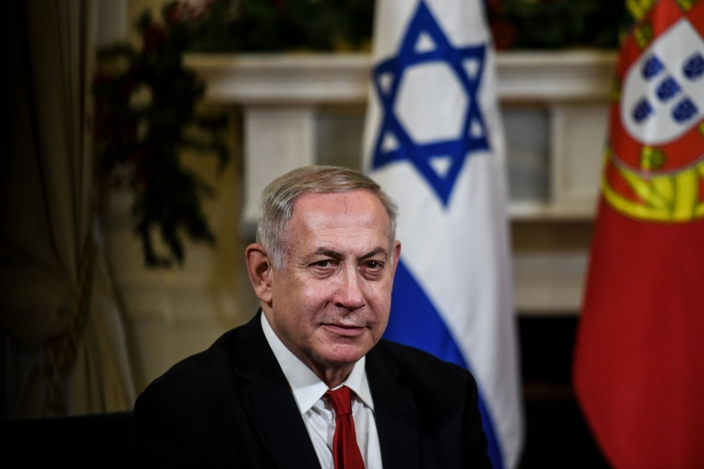 Israeli Prime Minister Benjamin Netanyahu attends a meeting with the Portuguese Prime Minister, not seen, at the Sao Bento Palace in Lisbon, Portugal, on Thursday. — AFP