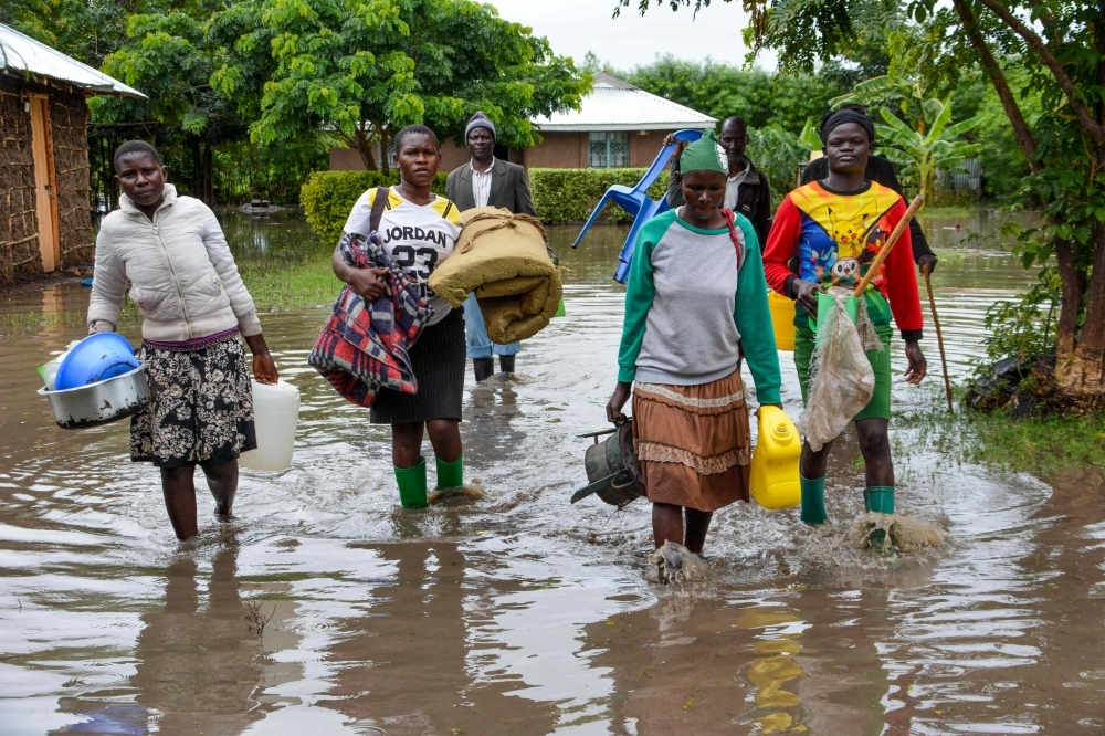 Displaced families flee to higher ground in K'akola village in Nyando sub-county in Kisumu after their houses were flooded in this Dec. 3, 2019 file photo. — AFP