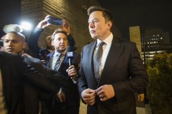 Elon Musk, chief executive officer of Tesla Inc. leaves the US District Court, Central District of California through a back door in Los Angeles, California, in this Dec. 3, 2019. — AFP