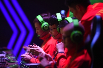 Gamers from the Vietnam team compete in the qualifying rounds of the eSports event between Malaysia and Vietnam at the SEA Games (Southeast Asian Games) in Manila on Thursday. — AFP