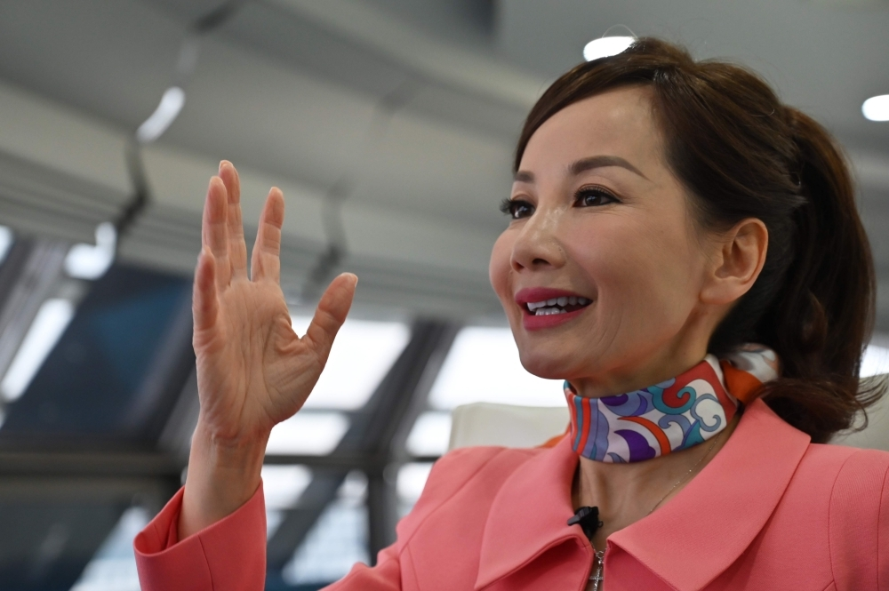 In this file photo taken on April 26, 2019 Travel services company CEO of Trip.com Jane Jie Sun Jie speaks during an interview with AFP in the facilities of Ctrip in Shanghai. The head of Chinese travel giant Trip.com, Jane Sun, is on a mission to propel women through her workforce, spearheading novel approaches. — AFP
