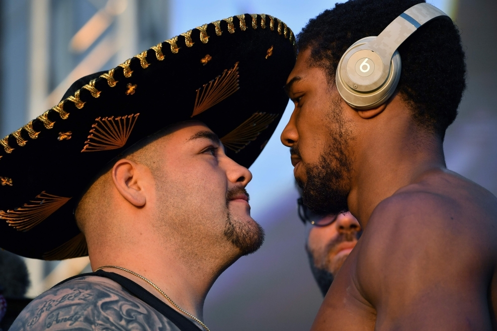 Mexican-American heavyweight boxing champion Andy Ruiz Jr (L) and British heavyweight boxing challenger Anthony Joshua pose during the official weigh-in at Diriyah in the Saudi capital Riyadh, on Friday, ahead of the upcoming