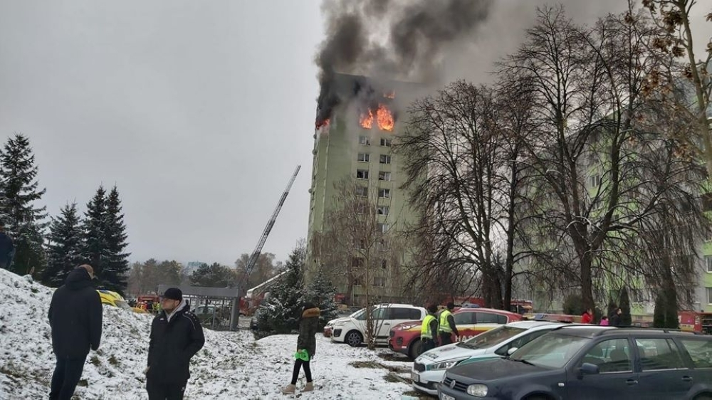 Emergency services work at the scene of a gas explosion in an apartment building in Presov, eastern Slovakia, on Friday. — AFP