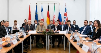 Iranian political deputy at the Ministry of Foreign Affairs of Iran Abbas Araghchi, center right, and German Secretary General of the European External Action Service (EEAS) Helga Maria Schmid, center left, attend a meeting of the Joint Commission on Iran's nuclear program (JCPOA) at EU Delegation to the International Organizations office in Vienna, Austria, on Friday. — AFP