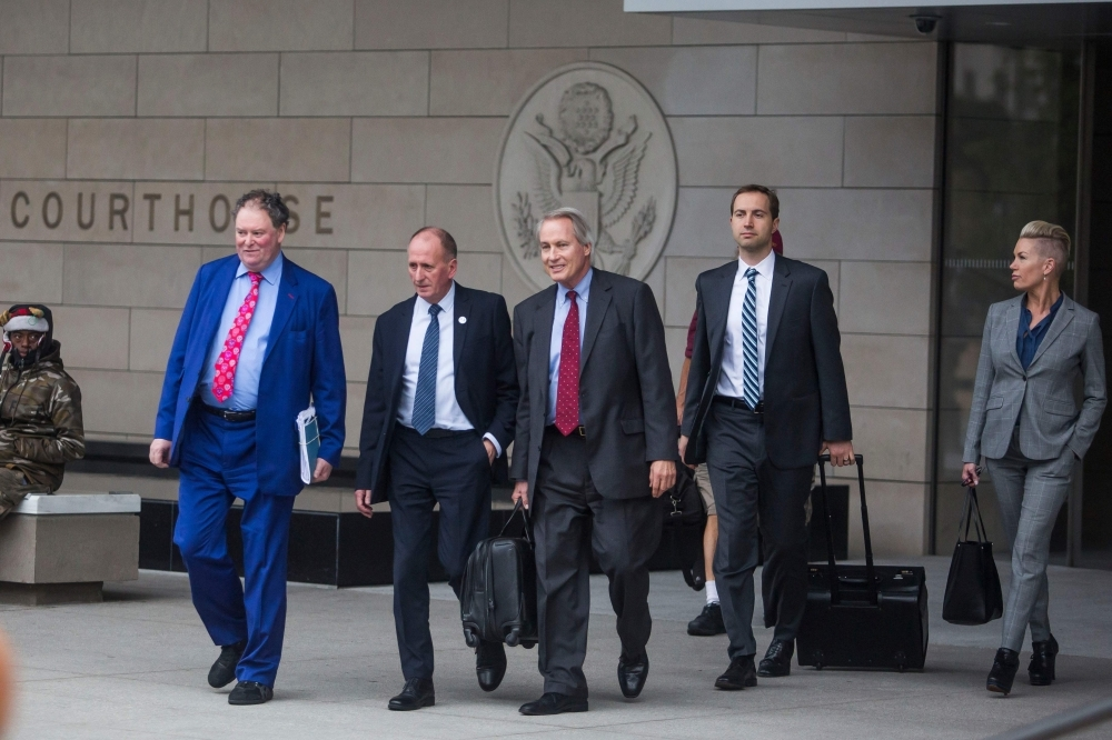 The British diver Vernon Unsworth (2L) and his attorneys, Mark Stephen (L) and L. Lin Wood (3L) leave the US District Court, Central District of California in Los Angeles on Friday. -AFP
