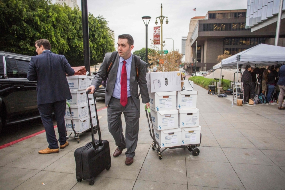 A man carries documents for the British diver Vernon Unsworth's attorneys at the US District Court, Central District of California in Los Angeles on Friday. -AFP