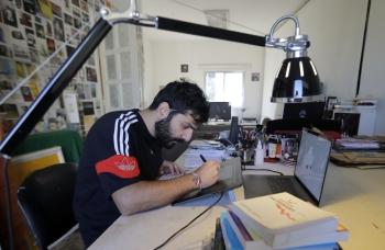 Lebanese cartoonist Bernard Haje works at his studio in Jal el-Dib, on the northern outskirts of the capital Beirut, on December 4, 2019. -AFP