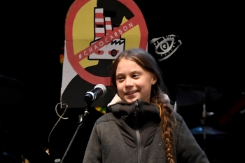 Swedish climate activist Greta Thunberg delivers a speech after a mass climate march to demand urgent action on the climate crisis from world leaders attending the COP25 summit, in Madrid, on Friday. Thousands of activists from around the globe will simultaneously hit the streets of Madrid and Santiago. — AFP