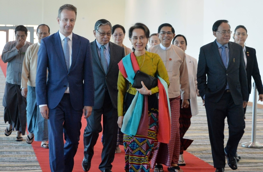 Myanmar State Counsellor Aung San Suu Kyi (C) leaves from Naypyitaw International Airport in Naypyidaw on Sunday, ahead of her appearance at the International Court of Justice in The Hague to defend the country against charges. -AFP