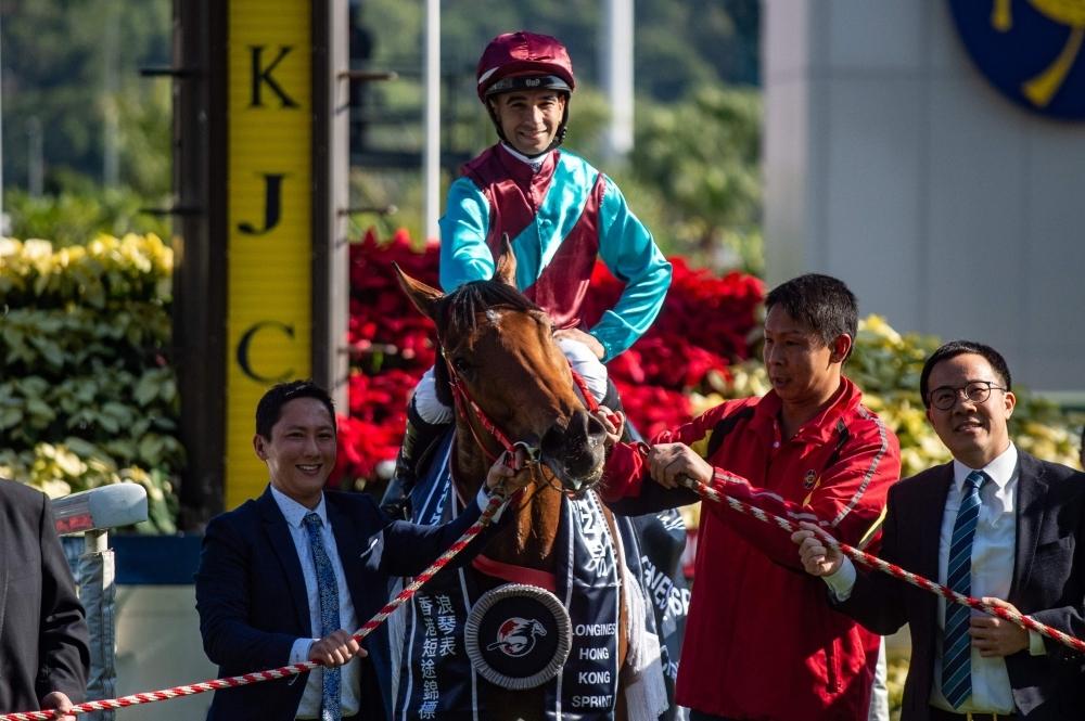 Brazilian jockey Joao Moreira rides on Beat the Clock to win the Hong Kong Sprint during the Hong Kong International Races at the Sha Tin Racecourse on Sunday. — AFP