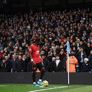 Fred of Manchester United looks to the crowd as missiles are thrown form the stands during the Premier League match between Manchester City and Manchester United at Etihad Stadium on Saturday in Manchester, United Kingdom. — AFP