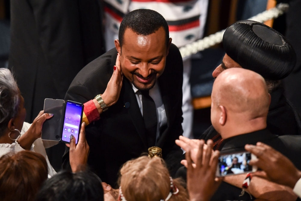 Ethiopia's Prime Minister and Nobel Peace Prize Laureate Abiy Ahmed Ali is greeted by well wishers after receiving the Nobel Peace Prize during a ceremony at the city hall in Oslo on Tuesday. — AFP