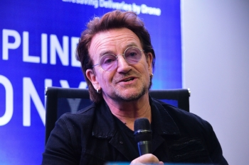 U2 frontman singer Bono speaks to the media during a signing ceremony in Manila on Tuesday. — AFP