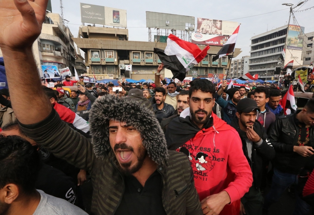 Iraqis gather at Tahrir square in the capital Baghdad amid ongoing anti-government protests on Tuesday. — AFP