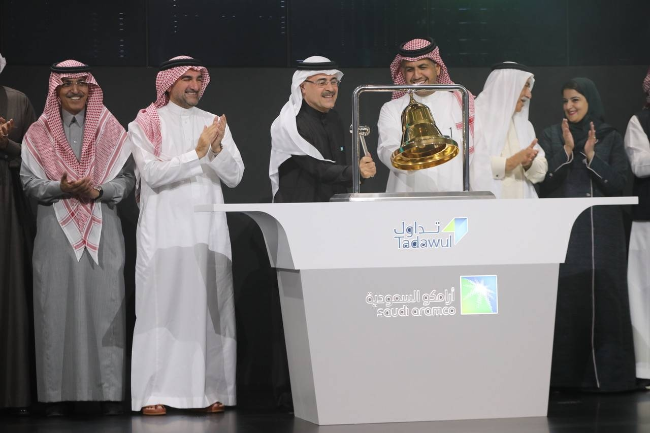 Saudi Aramco and Tadawul top officials mark the oil giant's first day of trading in Riyadh.