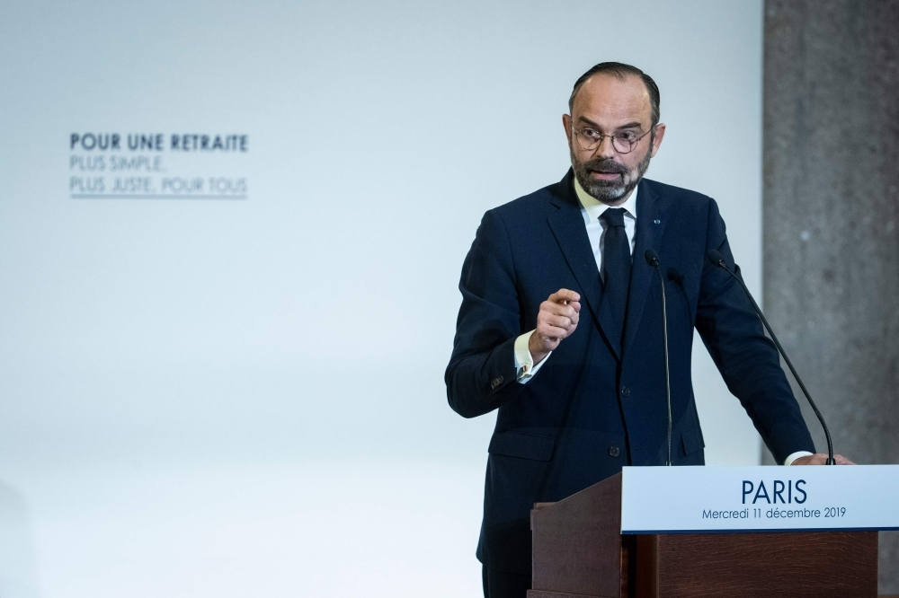 French Prime Minister Edouard Philippe unveils the details of a pension reform plan before the CESE (Economic, Social and Environmental Council) on Tuesday in Paris, as hundreds of thousands of people demonstrated the day before on the sixth day of a general strike.  — AFP