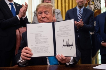 US President Donald Trump shows his signature on the Space Policy Directive-4 (SPD-4) at the White House in Washington in this Feb. 19, 2019 file photo. — AFP