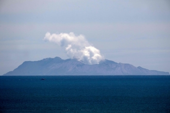 Steam rises from the White Island volcano following the Dec. 9 volcanic eruption, in Whakatane, New Zealand, on Wednesday. — AFP