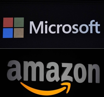 This combination of pictures created on Tuesday shows the Microsoft logo displayed during a presentation at the Mobile World Congress (MWC) in Barcelona, Spain, on February 24, 2019, and a file photo taken on Sept. 28, 2011 of the Amazon logo seen on a podium during a press conference in New York. — AFP