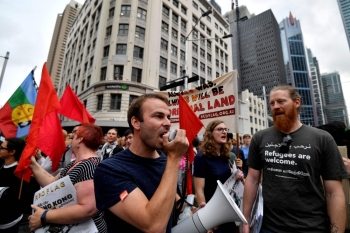 People chant slogans as they take part in a climate protest rally in Sydney on Wednesday. — AFP