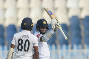 Sri Lanka's Dimuth Karunaratne scored a half-century on the first day. — AFP