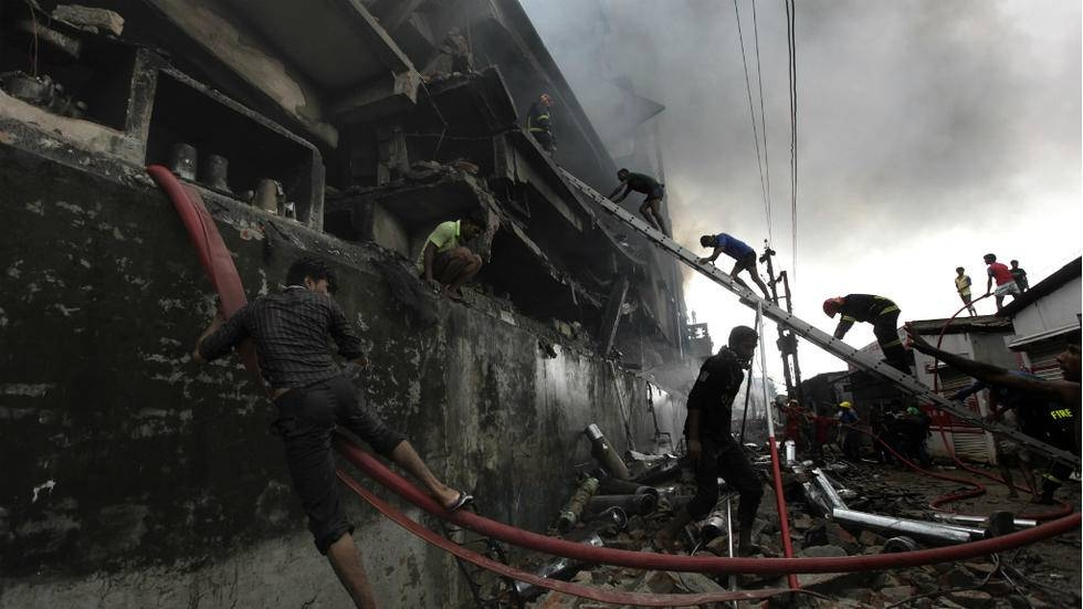 Bangladeshi firefighters and volunteers work to put out a fire and search for survivors at the site of an explosion in a factory near the capital Dhaka in this Sept. 10, 2016 file photo. — AFP
