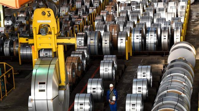 A worker packs coils for delivery at the production site of German steel technology group Salzgitter AG in Salzgitter, Germany, in this March 17, 2015 file photo. — AFP