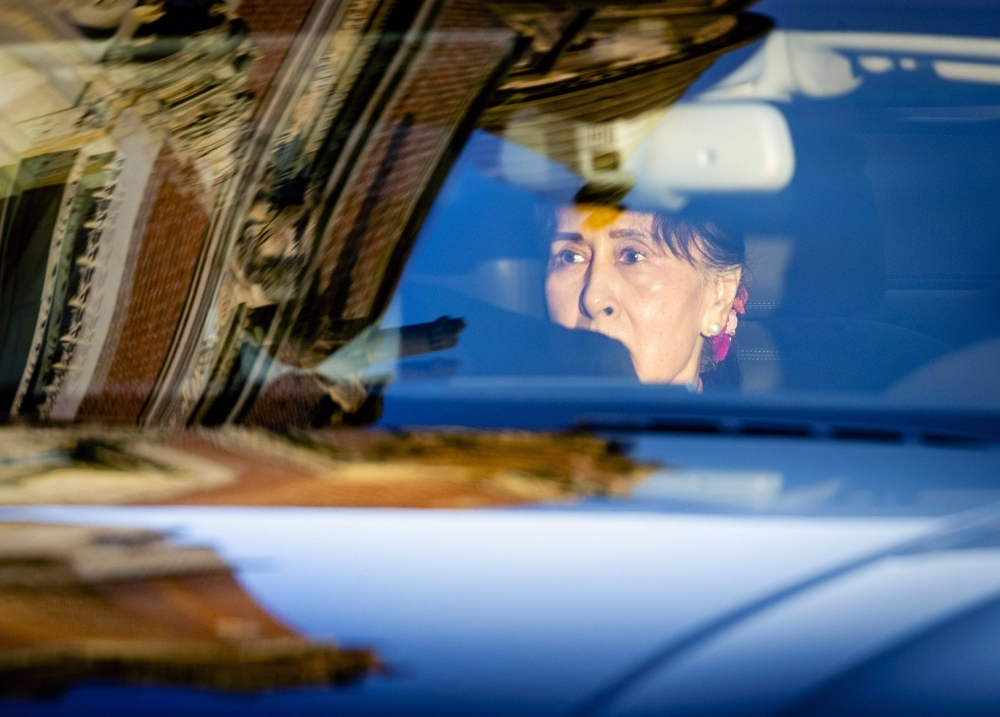 Myanmar's State Counsellor Aung San Suu Kyi arrives in a car on the last day of hearing on the Rohingya genocide case before the UN International Court of Justice at the Peace Palace in The Hague on Thursday. — AFP