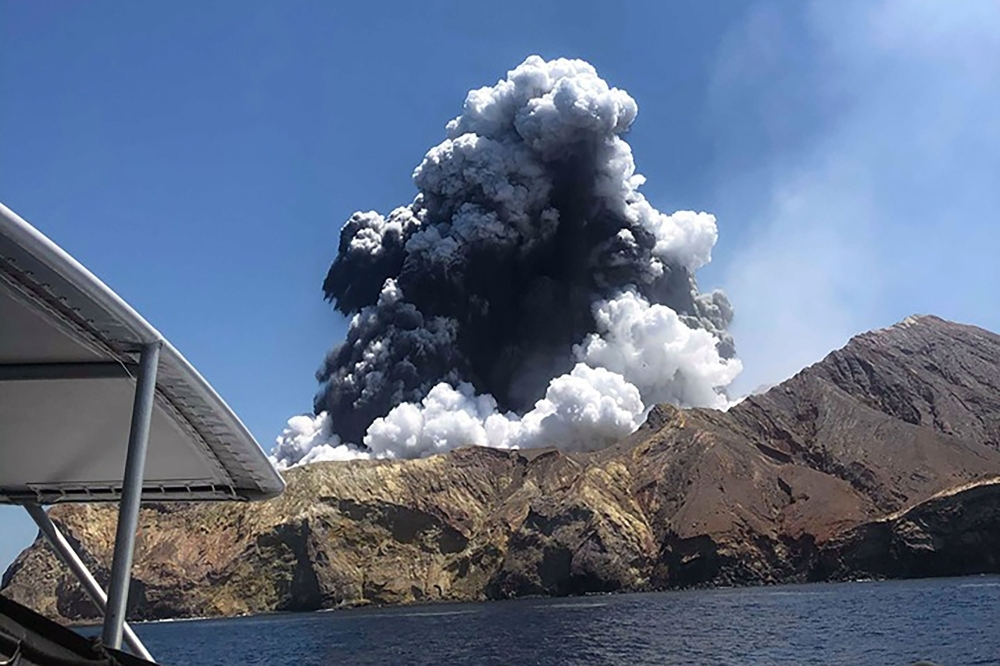 A plume of ash rises into the air as the volcano on White Island erupts off the coast of Whakatane on New Zealand's North Island in this Dec. 9, 2019 file photo. — AFP
