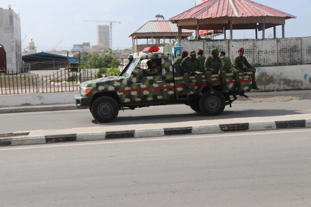 Somali government soldiers on a military vehicle are seen outside the SYL hotel in Mogadishu on Wednesday. — AFP
