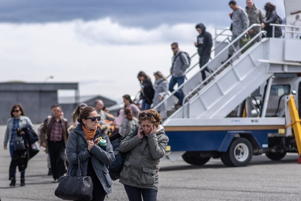 Relatives of people aboard the Chilean Air Force C-130 Hercules cargo plane that went missing in the sea between the southern tip of South America and Antarctica, arrive at Chabunco army base in Punta Arenas, Chile, on Wednesday. — AFP