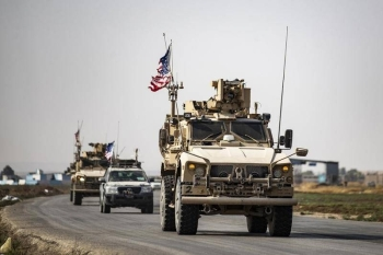 US military vehicles drive on a road toward Iraq after US forces pulled out of their Tal Tamr base in Northern Syrian in this Oct. 20, 2019 file photo. — AFP
