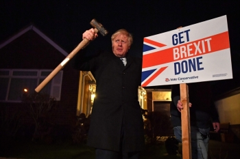 Britain's Prime Minister and Conservative party leader Boris Johnson poses after hammering a