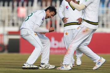 Pakistan's Mohammad Abbas celebrates after bowing out Sri Lanka's Dinesh Chandimal, not pictured, during the first day of the first Test cricket match between Pakistan and Sri Lanka at the Rawalpindi Cricket Stadium in Rawalpindi, Pakistan, on Wednesday. — AFP