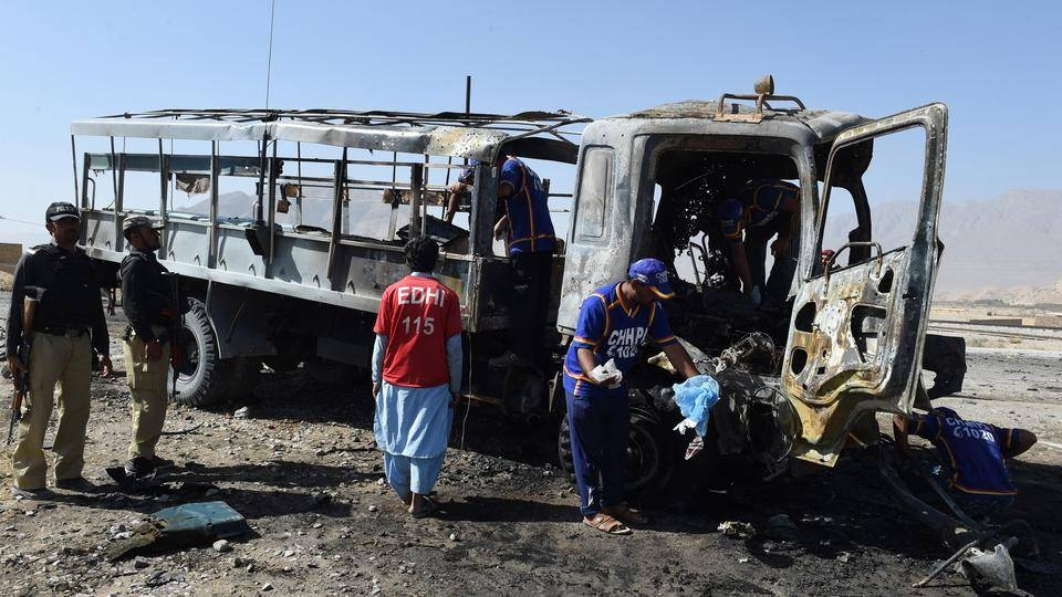 Investigators collect evidence from a burned police truck after a blast in Quetta, Pakistan, in this Oct. 18, 2017 file photo. — AFP