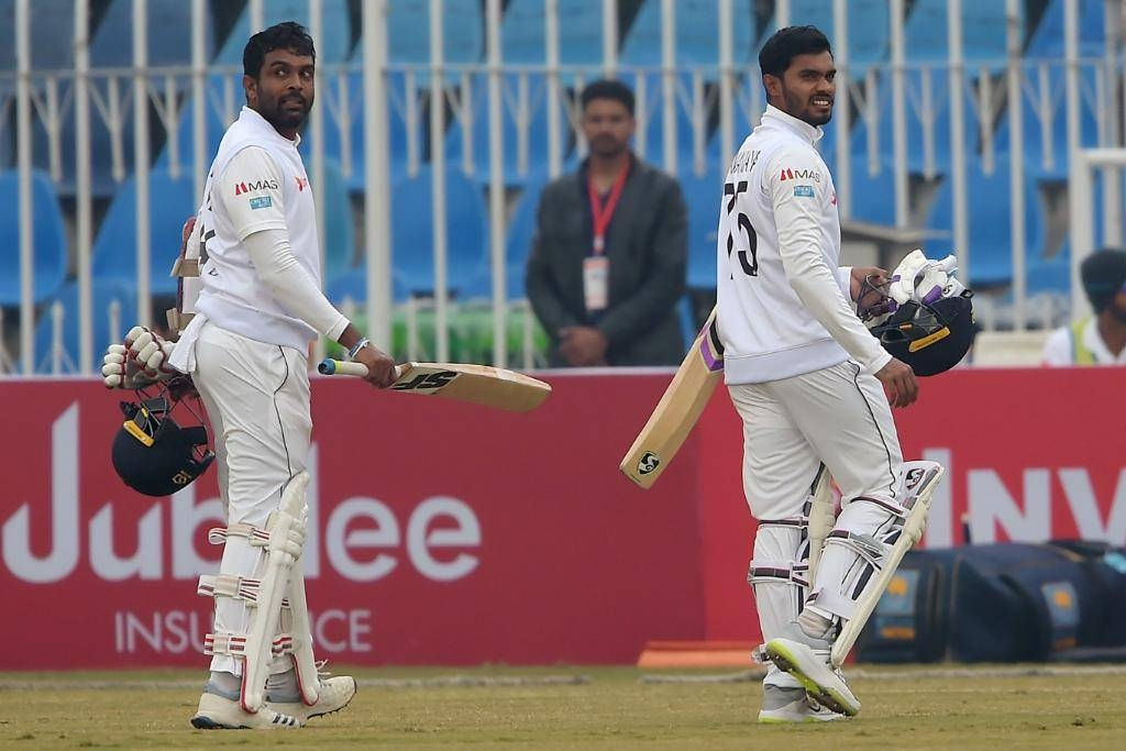 Sri Lanka's Dhananjaya de Silva and Dilruwan Perera walk back to the pavilion after a brief spell at he middle on a rain-hit third day of the Rawalpindi Test against Pakistan.