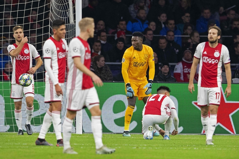 Ajax' Cameroonian goalkeeper Andre Onana (3rdR) and teammates react after Valencia scored the opener during the UEFA Champions League group H football match between Ajax Amsterdam and Valencia CF at the Johan Cruijff Arena in Amsterdam, The Netherlands on Dec. 10, 2019. —  AFP