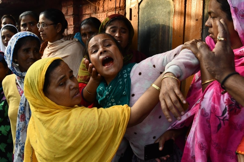 Relatives of Sam Stafford, 18, who was killed after police fired during a protest against the government's Citizenship Amendment Bill (CAB) a day before, react in Guwahati, Assam, on Friday. — AFP