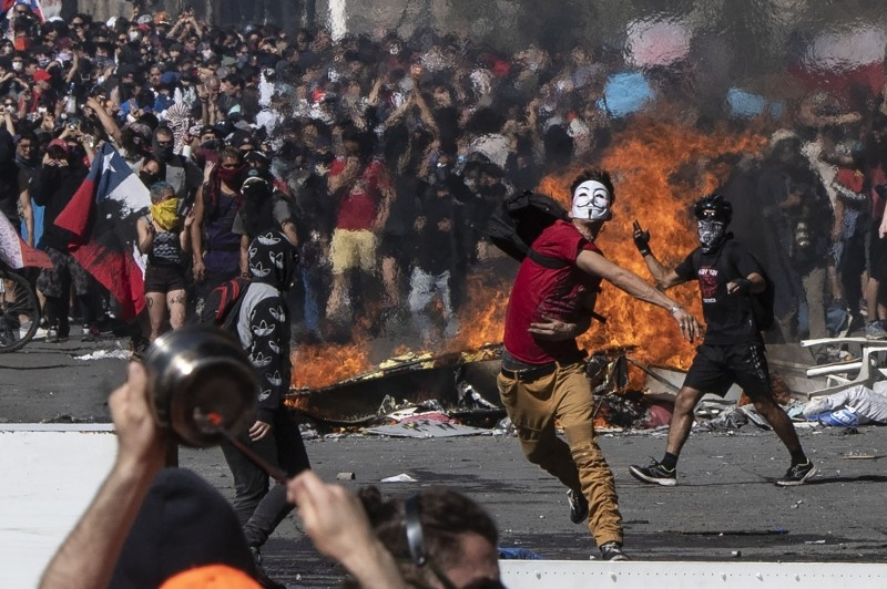 People demonstrate at Plaza Italia on the fifth straight day of street violence which erupted over a now suspended hike in metro ticket prices, in Santiago, Chile, in this Oct. 22, 2019 file photo. — AFP