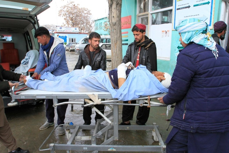 A wounded man is brought to a hospital after a vehicle was hit by a roadside bomb in Ghazni on Friday. — AFP