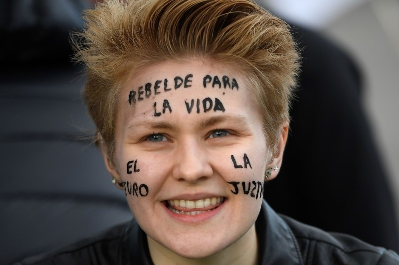 A demonstrator takes part in a protest on climate emergency, called by environmental groups including Extinction Rebellion and Fridays For Future, outside the UN Climate Change Conference COP25 at the 'IFEMA - Feria de Madrid' exhibition centre, in Madrid, on Friday. — AFP