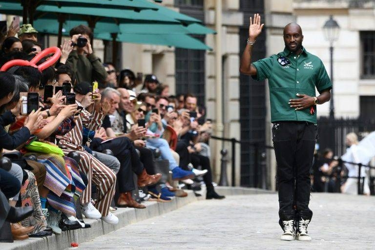 Virgil Abloh, the US designer, is applauded at a fashion show in this file photo. — AFP