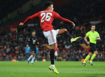 Manchester United's striker Mason Greenwood scores their fourth goal during the UEFA Europa League group L football match between Manchester United and AZ Almaar at Old Trafford in Manchester, north west England, on Thursday. — AFP
