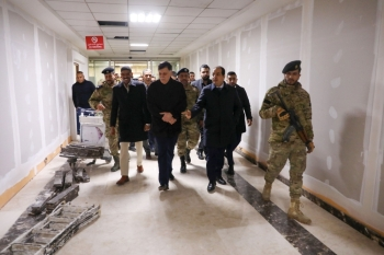 Libya's Tripoli-based Government of National Accord (GNA) Prime Minister Fayez Al-Sarraj, center, tours the Mitiga International Airport as it undergoes maintenance, ahead of it's reopening, in Tripoli in this Dec. 11, 2019 file photo. — AFP