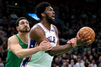 Enes Kanter No. 11 of the Boston Celtics fouls Joel Embiid No. 21 of the Philadelphia 76ers at TD Garden on Thursday in Boston, Massachusetts. The 76ers defeat the Celtics 115-109. — AFP